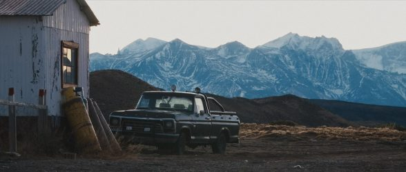 """An old derelict car parked at the Menelik Ranch in Patagonia - Still frame from the documentary """"Land of The Wind"""""""