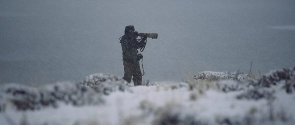 """Fine-art photographer Eliseo Miciu fights the snow photographing in the harsh Patagonian winter - Still frame from the documentary """"Land of The Wind"""""""